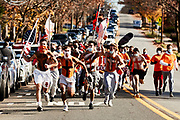 ORADELL, NJ - November 14: After 2 weeks off, the games have resumed, Bergen catholic is set to take on rival Don Bosco Prep. The historic tradition of Bergen Catholic students running down Oradell Avenue before games had been suspended for the season. A special request was made as the students honored their late classmate Kyle. The school allows them to carry on this tradition as long as they wore masks to adhere to protocols.<br /> <br /> We are in the midst of witnessing something this world has never experienced - a global pandemic. The coronavirus has swept away the world in March of 2020 - since then, the world we know It hasn't been the same. Jobs, businesses and futures have been put on hold and lost, yet, we have to power through to overcome one of the greatest obstacles this we have faced. The high school football season wasn't suppose to happen, but a glimmer of hope, intense safety measures & a little bit of luck has allowed for the season to start, now the question is ' Can It be completed?'<br /> <br /> Photo by Johnnie Izquierdo