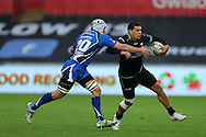Josh Matavesi of the Ospreys ® looks to go past Oliver Griffiths (l) of the Newport Gwent Dragons .Guinness Pro12 rugby match, Ospreys v Newport Gwent Dragons at the Liberty Stadium in Swansea, South Wales on 29th October 2016.<br /> pic by Andrew Orchard, Andrew Orchard sports photography.