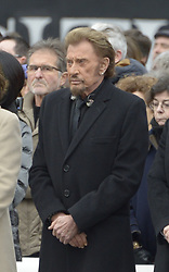 File photo : French singer Johnny Hallyday during a national tribute to the victims of the January and November 2015 terror attacks, at Place de la Republique square in Paris, France on January 9, 2016. France's biggest rock star Johnny Hallyday has died from lung cancer, his wife says. He was 74. The singer - real name Jean-Philippe Smet - sold about 100 million records and starred in a number of films. Photo by Henri Szwarc/ABACAPRESS.COM