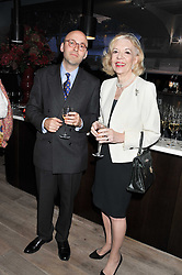 ANDREAS CAMPOMAR and UNA-MARY PARKER at a party to celebrate the publication of her  autobiography - The World According to Joan, held at the British Film Institute, South Bank, London SE1 on 8th September 2011.