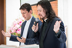 18 November 2018, Bogotá, Colombia: Rev. John Rojas (right) and Bishop Atahualpa Hernández (left) officiate Sunday service in the Church of San Lucas, here preparing for Holy Communion. The church of San Lucas ('Saint Lucas') of the Evangelical Lutheran Church of Colombia, brings together a congregation of some 100 people in the southern areas of Bogotá. Located in the Kennedy area, the church has recently celebrated 50 years. As part of its ministry, the church runs a school and college, The Colegio Evangelico Luterano de Colombia (CELCO) San Lucas, offering education to just over 1,000 students aged 3-18. The school started as a social initiative offering care for children aged 0-4 in Bogotá's less wealthy neighbourhood, allowing the parents opportunities to go to work. 36 years after its foundation, the school employs 56 staff, of which 36 are teachers.