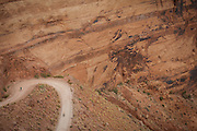 SHOT 10/17/16 11:20:27 AM - Mountain bikers climb and descend the Shafer Trail section of the White Rim Trail. The White Rim is a mountain biking trip in Canyonlands National Park just outside of Moab, Utah. The White Rim Road is a 71.2-mile-long unpaved four-wheel drive road that traverses the top of the White Rim Sandstone formation below the Island in the Sky mesa of Canyonlands National Park in southern Utah in the United States. The road was constructed in the 1950s by the Atomic Energy Commission to provide access for individual prospectors intent on mining uranium deposits for use in nuclear weapons production during the Cold War. Four-wheel drive vehicles and mountain bikes are the most common modes of transport though horseback riding and hiking are also permitted.<br /> (Photo by Marc Piscotty / © 2016)