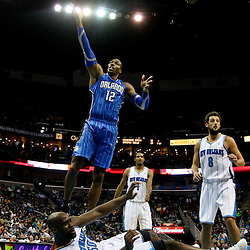 January 27, 2012; New Orleans, LA, USA; Orlando Magic center Dwight Howard (12) shoots over New Orleans Hornets center Emeka Okafor (50) during a game at the New Orleans Arena. The Hornets defeated the Magic 93-67.  Mandatory Credit: Derick E. Hingle-US PRESSWIRE