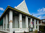 15 JULY 2015 - THONBURI, BANGKOK, THAILAND:  The west side of Bang Luang Masjod (Masjid is the Thai word for mosque). Located on the west bank of the Chao Phraya River and built in the reign of King Rama I (1782-1809), Bangluang Mosque is one of the oldest mosques in Bangkok and is unique because it's designed in a traditional Thai style and decorated with Thai, European, and Chinese art. The Mosque carries Islamic symbolic features such as 30 pillars, 12 windows and 1 door which represent the numbers of chapters in the Koran and the 13 regulations of Islamic worshipping ritual.    PHOTO BY JACK KURTZ