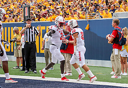 Sep 14, 2019; Morgantown, WV, USA; North Carolina State Wolfpack running back Jordan Houston (20) scores a touchdown and celebrates with North Carolina State Wolfpack wide receiver Emeka Emezie (3) during the second quarter against the West Virginia Mountaineers at Mountaineer Field at Milan Puskar Stadium. Mandatory Credit: Ben Queen-USA TODAY Sports