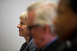 © Licensed to London News Pictures. 23/07/2015. London, UK. British home Secretary THERESA MAY listens before delivering a speech on the relationship between police and the community at Brixton Recreation Centre in Brixton, south London.  Photo credit: Ben Cawthra/LNP