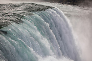 SHOT 10/21/17 12:34:03 PM - The American Falls is the second-largest of the three waterfalls that together are known as Niagara Falls on the Niagara River along the Canada–U.S. border. Unlike the much larger Horseshoe Falls, of which two-thirds is located in Ontario, Canada and one-third in the U.S. state of New York, the American Falls is entirely within the United States. Located on the Niagara River, which drains Lake Erie into Lake Ontario, the combined falls form the highest flow rate of any waterfall in North America that has a vertical drop of more than 165 feet (50 m). During peak daytime tourist hours, more than six million cubic feet of water goes over the crest of the falls every minute. Horseshoe Falls is the most powerful waterfall in North America, as measured by flow rate. Niagara Falls is famed both for its beauty and as a valuable source of hydroelectric power. The falls are 17 miles (27 km) north-northwest of Buffalo, New York. Buffalo, N.Y. is the second most populous city in the state of New York and is located in Western New York on the eastern shores of Lake Erie and at the head of the Niagara River. By 1900, Buffalo was the 8th largest city in the country, and went on to become a major railroad hub, the largest grain-milling center in the country and the home of the largest steel-making operation in the world. The latter part of the 20th Century saw a reversal of fortunes: by the year 1990 the city had fallen back below its 1900 population levels. (Photo by Marc Piscotty / © 2017)