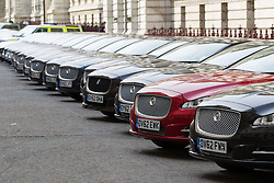 © Licensed to London News Pictures . 17/04/2013 . London , UK . The road outside the Foreign and Commonwealth Office off Whitehall resembles a car showroom this afternoon (Wednesday 17th April) as dozens of identical Jaguar and Land Rover Cars are parked outside . The vehicles are being used by the police to transport dignitaries , in the City , who have attended the funeral of Margaret Thatcher . Many have sequential number plates . Photo credit : Joel Goodman/LNP