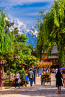 The Old Town (Dayan) of Lijiang, Yunnan Province, China with the massive Jade Dragon Snow Mountain in the background. The Old Town is a UNESCO World Heritage Site.. The Old Town is a UNESCO World Heritage Site.