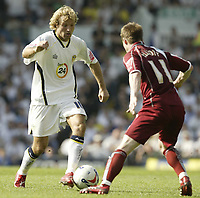 Photo: Aidan Ellis.<br /> Leeds United v Burnley. Coca Cola Championship. 14/04/2007.<br /> Leeds Michael Gray (L) attacks Burnley's Wade Elliott