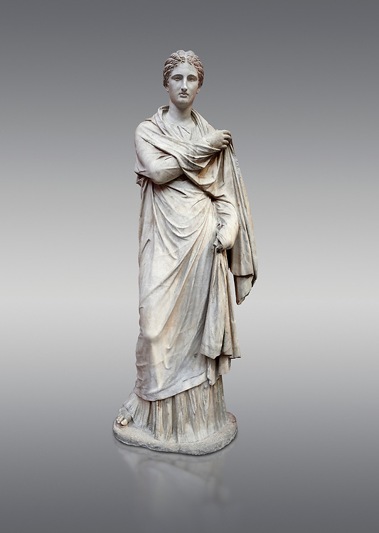 Ancient Greek funerary statue of a women, type Small Herculaneum Woman style. From Delos circa 2nd Cent BC. Athens National Archaeological Museum. Cat No 1827. Against grey<br /> <br /> This marble statue from Delos shopws a women wearing a full length chiton and a himation that covers her entire body and arms. This style of statue is known os 'Small Herculaneum Woman' and is a copy of a famous original dating from 300 BC. .<br /> <br /> If you prefer to buy from our ALAMY STOCK LIBRARY page at https://www.alamy.com/portfolio/paul-williams-funkystock/greco-roman-sculptures.html . Type -    Athens    - into LOWER SEARCH WITHIN GALLERY box - Refine search by adding a subject, place, background colour, etc.<br /> <br /> Visit our ROMAN WORLD PHOTO COLLECTIONS for more photos to download or buy as wall art prints https://funkystock.photoshelter.com/gallery-collection/The-Romans-Art-Artefacts-Antiquities-Historic-Sites-Pictures-Images/C0000r2uLJJo9_s0