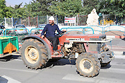 Israel, Golan Heights, The Druze vilege Massade Local man drives his tractor to the fields