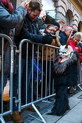 03.12.2017, Innenstadt, Graz, AUT, Krampus- und Perchtenlauf in Graz, im Bild Mitglieder verschiedener Krampusgruppen beim Krampusumzug // A man dressed as a devil performs during a Krampus show. Krampus a mythical creature that, according to legend, accompanies Saint Nicholas during the festive season. Instead of giving gifts to good children, he punishes the bad ones, Graz, Austria on 2017/12/03, EXPA Pictures © 2017, PhotoCredit: EXPA/ Erwin Scheriau