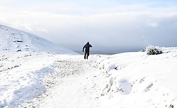© Licensed to London News Pictures. 04/12/2020. <br /> A walker heads along the slopes of Penyfan, in the Brecon Beacons, the highest point in southern Wales and England, which has seen it's first snowfall of the year. Photo credit: Robert Melen/LNP