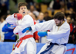 Jure Koren of Slovenia (red) fighting against Artem Zhegaliuk of Ukraine (blue) during Kumite Individual male Seniors -75 kg at Day One of Karate 1 World Cup - Thermana Slovenia Lasko 2014 tournament, on March 15, 2014 in Arena Tri Lilije, Lasko, Slovenia.Photo by Vid Ponikvar / Sportida
