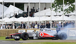 © Licensed to London News Pictures. 30/06/2012 .F1 star Lewis Hamilton takes to the track at Goodwood..The Goodwood Festival of Speed is the largest motoring garden party in the world - a unique summer weekend, The largest car culture event in the world. Held in the grounds of Goodwood House,Chichester..Photo credit : Grant Falvey/LNP