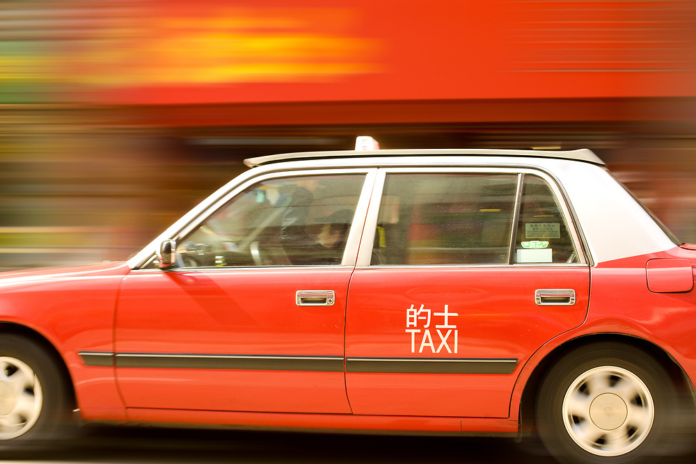Central district, Hong Kong, China, Asia - Panning of a taxi in the streets of Hong Kong.
