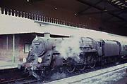 Salisbury railway station, BR standard class steam engine 'King Pellinore', Salisbury railway station, Wiltshire, England, UK 1960s