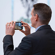 Hillsboro School District superintendant Mike Scott takes a video during a ribbon cutting ceremony in the new gymnasium at Eastwood Elementary School in Hillsboro, Ore., on Tuesday, Feb. 4, 2020.