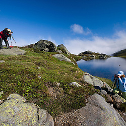 Photographers at one of the two Lakes of the Clouds in the col between Mount Washington and Mount Monroe in New Hampshire's White Mountains.