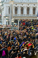 Massive crowds of tourists cross over the Bridge of Sighs to Piazza San Marco, Venice, Italy.
