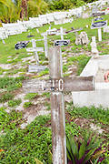 Old wooden grave marker in the Cholera Cemetery of Hope Town, Elbow Cay Abacos, Bahamas.