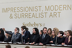 © Licensed to London News Pictures. 01/03/2017. London, UK. Sotheby's staff make bids on behalf of telephone clients at the evening sale of Impressionist and Surrealist Art at Sotheby's in New Bond Street. Photo credit : Stephen Chung/LNP