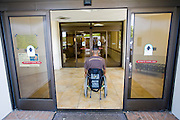 Felipe Adams, a 30-year-old Iraq war veteran who was paralyzed by a sniper's bullet in Baghdad, Iraq arrives at the VA Long Beach Medical Center in Inglewood, California for his exercises.    (Felipe Adams is featured in the book What I Eat: Around the World in 80 Diets.) MODEL RELEASED.