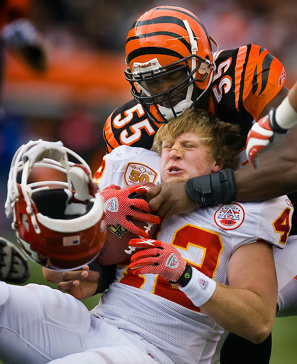 Kansas City Chiefs fullback Mike Cox had his helmet fly off after a hit by Cincinnati Bengals linebacker Keith Rivers (55) in the second quarter on December 27, 2009 at Paul Brown Stadium in Cincinnati, OH. The Chiefs lost 17-10.