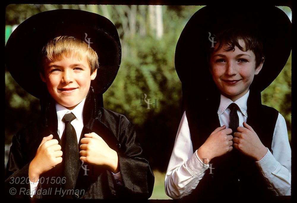 Two boys in traditional Breton outfits @ pardon festival in town of Crac'h;Morbihan/Brittany France