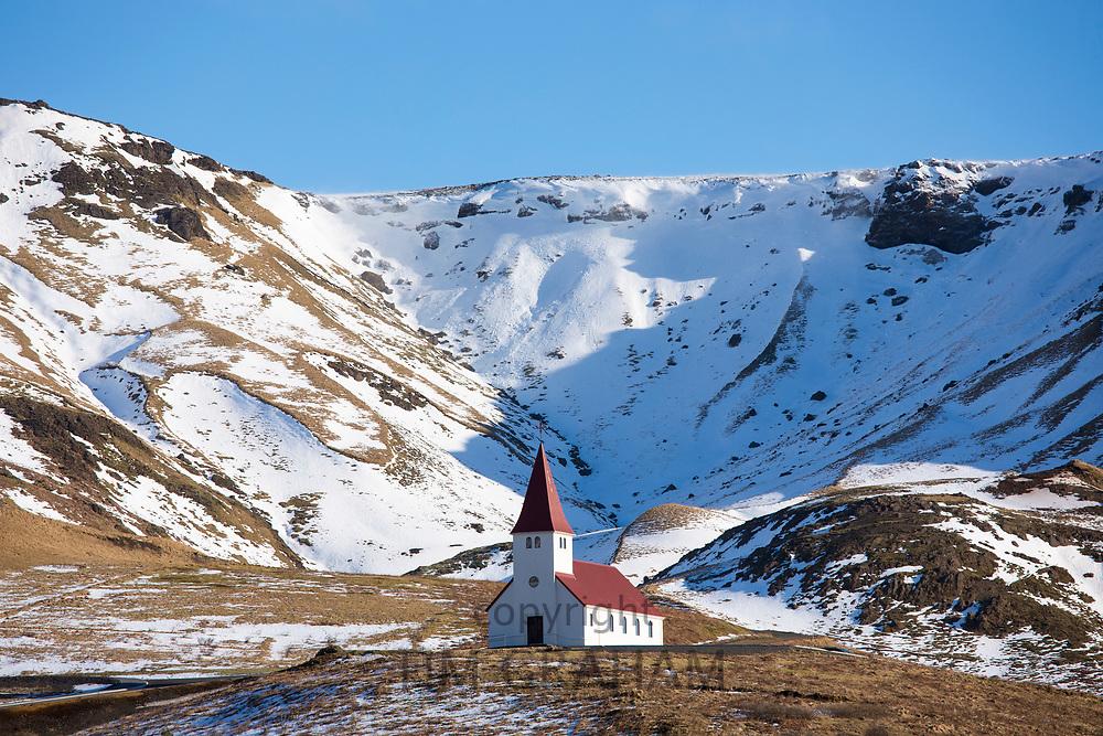 Traditional quaint Icelandic wooden Lutheran church Vikurkirkja at Vík i Myrdal, South Iceland