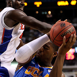 Mar 19, 2011; Tampa, FL, USA; Florida Gators forward/center Patric Young (4) defends against UCLA Bruins center Joshua Smith (34) during second half of the third round of the 2011 NCAA men's basketball tournament at the St. Pete Times Forum. Florida defeated UCLA 73-65.  Mandatory Credit: Derick E. Hingle