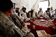 Embedded with the US Army, 3rd brigade combat team, 10th Mountain division in the highly volatile Logar province of Afghanistan in early May 2009...Photo: Guilad Kahn. Shura council meeting at COP (Combat OutPost) Baugess with the Capt. McQuade, Company Commander.
