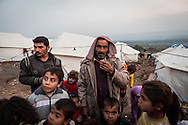 Abu Ghaith, centre, with some of his children and grandchildren in Atmeh camp for internally displaced Syrians, on the border with Turkey. More than 12,000 people from across Syria live in the camp set up when Turkish camps became full. 02/01/2013