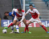 Fleetwood Town's Antoni Sarcevic battles with Gillingham's Bradley Dack<br /> <br /> Photographer Stephen White/CameraSport<br /> <br /> Football - The Football League Sky Bet League One - Gillingham v Fleetwood Town -  Friday 3rd April 2015 - MEMS Priestfield Stadium - Gillingham<br /> <br /> © CameraSport - 43 Linden Ave. Countesthorpe. Leicester. England. LE8 5PG - Tel: +44 (0) 116 277 4147 - admin@camerasport.com - www.camerasport.com