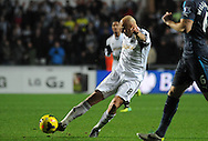 Jonjo Shelvey has a shot at the Newcastle goal.<br /> Barclays Premier League match, Swansea city v Newcastle Utd at the Liberty stadium in Swansea, South Wales on Wednesday 4th Dec 2013. pic by Phil Rees, Andrew Orchard sports photography,