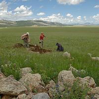 MONGOLIA. Smithsonian Museum archaeology team studies 2700+ year-old,  khirigsur burial mound at Ulaan Tolgai site near Lake Erkhel & Muren.  <br /> <br /> MS0702_060630_0234.NEF