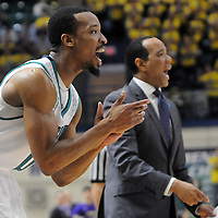 UNCW's Craig Ponder reacts next to head coach Kevin Keatts in the game against James Madison at Trask Coliseum on Saturday. Mike Spencer/StarNews