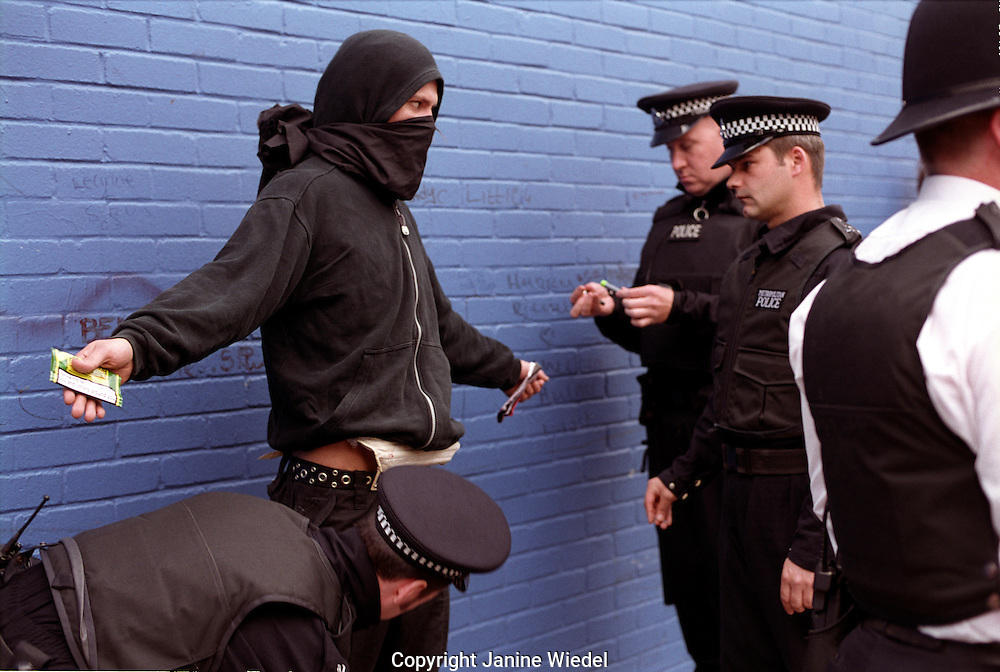 Young demonstrator being searched by police under section 44 at a 2001 arms trade Fair at Excel Center demonstration in London