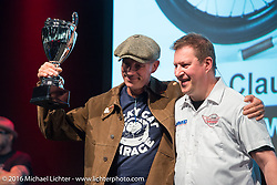 Jean-Claude Barrois gets a trophy for his homemade Rudge racer at the AMD World Championship of Custom Bike Building Award Ceremony on the stage in the custom dedicated Hall 10 at the Intermot Motorcycle Trade Fair. Cologne, Germany. Sunday October 9, 2016. Photography ©2016 Michael Lichter.