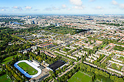 Nederland, Noord-Holland, Amsterdam, 27-09-2015; Amsterdam-Oost, Watergraafsmeer. Sportpark Middenmeer, met Jaap Edenbaan. Foto richting Park Frankendael em Amsterdam-Zuid, Amsteal aan de horizon (links).<br /> Sport park, Amsterdam East with Ice skating rink.<br /> <br /> luchtfoto (toeslag op standard tarieven);<br /> aerial photo (additional fee required);<br /> copyright foto/photo Siebe Swart