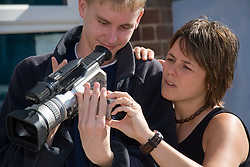 Training programme Coordinator explaining to Entry 2 Employment students how to use a video camera; Sycamore Centre Nottingham,