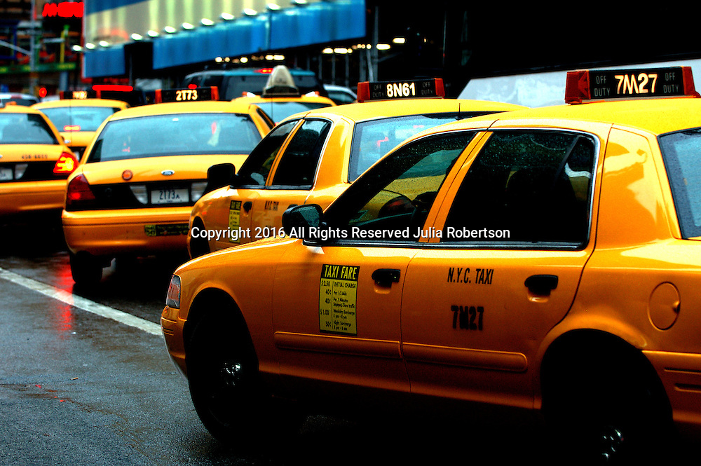 Taxi cabs in manhattan NYC Rush Hour Street Scene with traffic of taxis