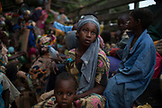 A girl sits at the back of a truck as she prepares to flee sectarian violence with other Muslim families in a convoy escorted by African Union (AU) peacekeepers towards the border with Cameroon, in the town of Bouar, west of the Central African Republic March 9, 2014.