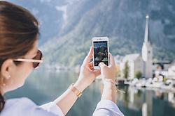 THEMENBILD - eine Frau beim fotografieren mit ihrem Smartphone, aufgenommen am 17. April 2019 in Hallstatt, Österreich // a woman taking pictures with her smartphone in Hallstatt, Austria on 2020/04/17. EXPA Pictures © 2020, PhotoCredit: EXPA/ JFK