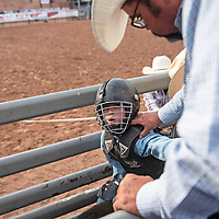 Aaden Gonzales, 11, and his father Michael Gonzales exchange glances moments before Aaeden's turn in steer riding Wednesday, June 12 at Red Rock Park during the Gallup Lions Club youth rodeo.