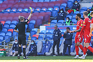 YELLOW CARD Nottingham Forest's Cyrus Christie (2) is shown a yellow card by referee Gavin Ward during the EFL Sky Bet Championship match between Cardiff City and Nottingham Forest at the Cardiff City Stadium, Cardiff, Wales on 2 April 2021.