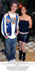 The HON.REBECCA MACMILLAN and her brother VISCOUNT MACMILLAN at a party in London on 28th April 2004.PTO 229