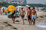 A trader is seen along the beach of Durres as Albanian vacationers are seen enjoying a sunny day on Saturday, July 4, 2009. (Photo by Vudi Xhymshiti)