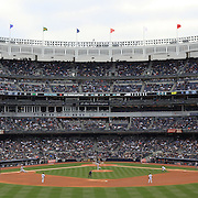 A panorama image of Yankee Stadium in the Bronx during the New York Yankees V Detroit Tigers Baseball game at Yankee Stadium, The Bronx, New York. 28th April 2012. Photo Tim Clayton.. Note to Editors. This image is a composite of two images taken a split second apart and merged in editing.